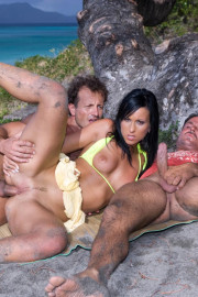 Tropical threesome on the beach 2 of 12